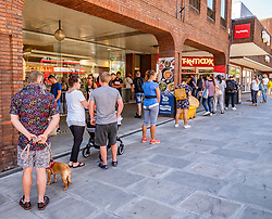 © Licensed to London News Pictures. 15/06/2020. London, UK. Shoppers in Kingston, South West London as non essential shops are given the green light to open in England after 3 months of being closed due to the coronavirus pandemic. Also commuters are told to wear face masks from Monday while travelling on Public transport. Photo credit: Alex Lentati/LNP