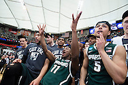 29 MAR 2015: Lourawls Nairn Jr. (11)  and Michigan State University teammates  celebrate their victory over the University of Louisville during the 2015 NCAA Men's Basketball Tournament held at the Carrier Dome in Syracuse, NY. Michigan State defeated Louisville 76-70 to advance. Brett Wilhelm/NCAA Photos