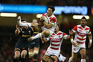 Alex Cuthbert of Wales tackles Akihito Yamada of Japan. Under Armour 2016 series international rugby, Wales v Japan at the Principality Stadium in Cardiff , South Wales on Saturday 19th November 2016. pic by Andrew Orchard, Andrew Orchard sports photography