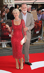 Red 2 UK film premiere.<br /> Dame Helen Mirren with husband during the premiere of the sequel to 2010's graphic novel adaption, about a group of retired assassins. <br /> Empire Leicester Square<br /> London, United Kingdom<br /> Monday, 22nd July 2013<br /> Picture by i-Images