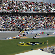 NASCAR Sprint Cup drivers Dale Earnhardt Jr. (88), Marcos Ambrose (9), Tony Stewart (14) and Trevor Bayne (21) are involved in a crash on the front stretch during the 56th Annual NASCAR Coke Zero 400 race at Daytona International Speedway on Sunday, July 6, 2014 in Daytona Beach, Florida.  (AP Photo/Alex Menendez)