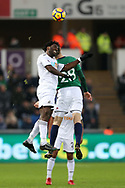 Wilfried Bony of Swansea city jumps for a header with Sam Field of West Bromwich Albion. Premier league match, Swansea city v West Bromwich Albion at the Liberty Stadium in Swansea, South Wales on Saturday 9th December 2017.<br /> pic by  Andrew Orchard, Andrew Orchard sports photography.
