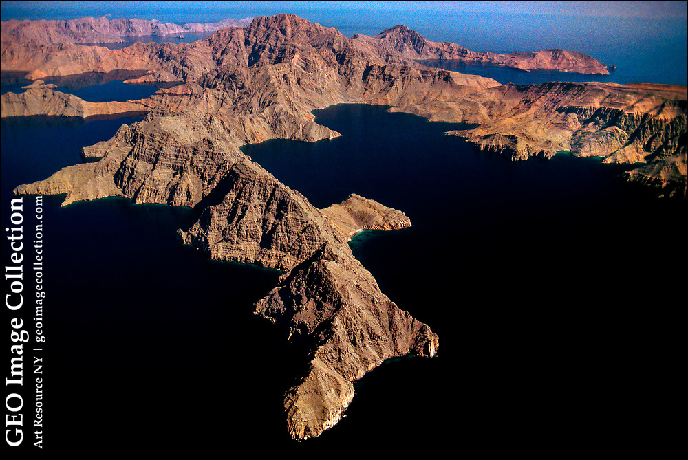 Stark rock outcroppings of Oman's Musandam Peninsula jut into the strategic Strait of Hormuz, a narrow waterway on the Persian Gulf coast that separates Oman from Iran.  A third of the world's liquefied natural gas and almost 25 percent of total global oil consumption passes through the Strait of Hormuz — making it the world's most important petroleum choke point.