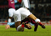 Photo: Chris Ratcliffe.<br />West Ham United v Newcastle United. The Barclays Premiership. 17/12/2005.<br />Bobby Zamora is turned upside down as West Ham lose.