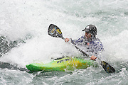 A Kayaker practicing his sport along the Elwha River, Olympic NP.