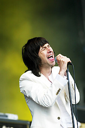 Bobby Gillespie, lead singer and founding member of the alternative rock band, Primal Scream, play on the main stage at T in the Park, 13/7/2002..Pic: © Michael Schofield.