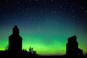Northern lights (aurora borealis) and grain elevator in ghost town<br /> Bents<br /> Saskatchewan<br /> Canada