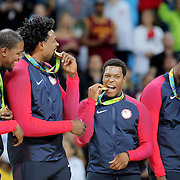 Basketball - Olympics: Day 16   DeAndre Jordan #6 of United States and Kyle Lowry #7 of United States check their medal after the gold medal presentation after the USA Vs Serbia Men's Basketball Gold Medal game at Carioca Arena1on August 21, 2016 in Rio de Janeiro, Brazil. (Photo by Tim Clayton/Corbis via Getty Images)