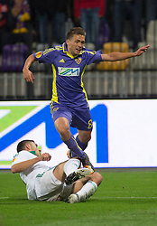 Dejan Mezga of NK Maribor falls over player during football match between NK Maribor and Panathinaikos Athens F.C. (GRE) in 1st Round of Group Stage of UEFA Europa league 2013, on September 20, 2012 in Stadium Ljudski vrt, Maribor, Slovenia. (Photo By Matic Klansek Velej / Sportida)