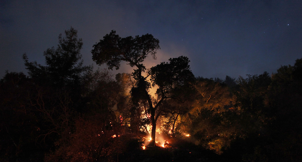 An eight-second exposure shows the Pfeiffer Fire burning along Highway 1 in Big Sur, Calif. on Dec. 18, 2013.
