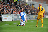 John Joe O 'Toole of Bristol Rovers on his knees as David Pipe of Newport County looks on.Skybet League two match, Newport county v Bristol Rovers at Rodney Parade in Newport, South Wales on Saturday 17th August 2013.  pic by Phil Rees ,Andrew Orchard sports photography,