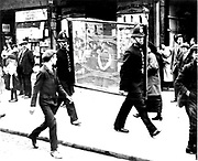 World War I - 1914-1918: Anti-German riots in Poplar, London.  Police carrying wire netting in a wooden frame for protecting shop windows.   Photograph.