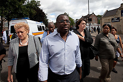 © Licensed to London News Pictures. 07/08/2011. Tottenham, UK.Tottenham MP David Lammy arrives to survey the devestation in Tottenham following a night of rioting, vandalism and looting. Photo credit : Joel Goodman/LNP