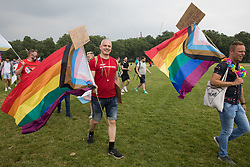 LGBTI+ protesters hold Progress Pride flags as the first-ever Reclaim Pride march arrives in Hyde Park for a Queer Picnic on 24th July 2021 in London, United Kingdom. Reclaim Pride replaced the traditional Pride in London march, which many feel has become too commercial and strayed from its roots in protest, and was billed as a People's Pride march for LGBTI+ liberation. Campaigners called for the banning of LGBTI+ conversion therapy, the reform of the Gender Recognition Act, the provision of a safe haven for LGBTI+ refugees and for LGBTI+ people to be decriminalised worldwide and marched in solidarity with Black Lives Matter.