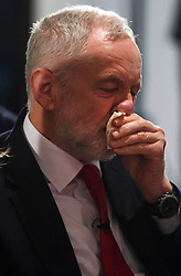 © Licensed to London News Pictures. 09/04/2018. London, UK. Labour Party leader JEREMY CORBYN wipes his nose during the launch event for the Labour Party local election campaign launch in central London.  Labour are expected to make gains in the capital, potentially taking traditionally Conservative strongholds. Photo credit: Ben Cawthra/LNP