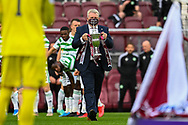 Hearts Chief Executive Andrew McKinlay carries the Championship trophy onto the field before the Cinch SPFL Premiership match between Heart of Midlothian FC and Celtic FC at Tynecastle Park, Edinburgh, Scotland on 31 July 2021.