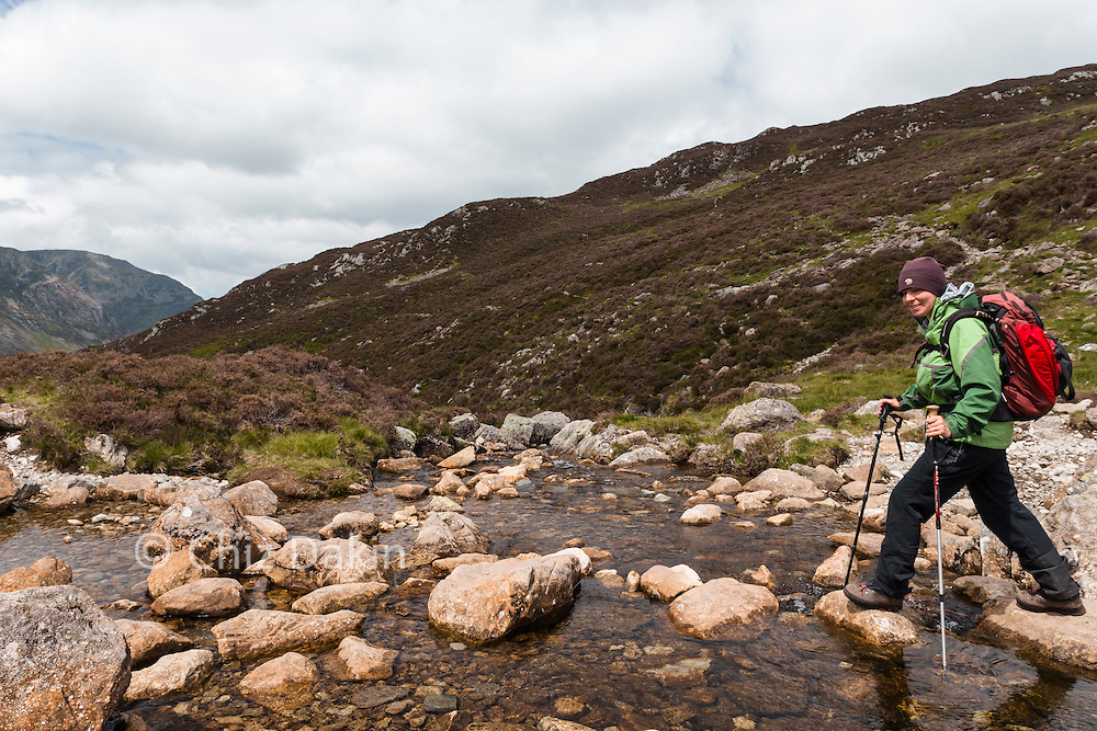 Crossing Wharnscale Beck on stepping stones near Dubs Quarry