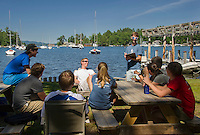 Junior Directors Ben Crosby (sitting white shirt) and Liam Shanahan (standing blue shirt) meet with this years instructors for preparations for the 2015 season with Lake Winnipesaukee Sailing Association in Smith Cove on Wednesday afternoon.  Karen Bobotas/for the Laconia Daily Sun)