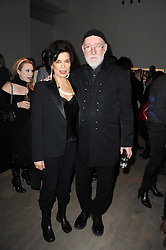 BIANCA JAGGER and ALBERT WATSON at a private view of Masters of Photography - A Journey presented by Macallan and Albert Watson held at Philips De Pury, Howick Place, London SW1 on 1st December 2010.