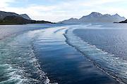 Wake of Hurtigruten ferry ship in water of Raftsundet strait of Hinnoya Island, Nordland, northern Norway