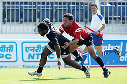 Tomasi Cama on his way to the try line during the XIX Commonwealth Games 7s rugby match between New Zealand and Canada held at The Delhi University in New Delhi, India on the  10 October 2010..Photo by:  Ron Gaunt/photosport.co.nz