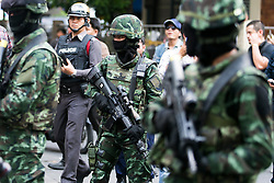© Licensed to London News Pictures. 24/05/2014. Armed Thai army soldiers about to confront anti-coup protestors following a Anti-Coup protest in Bangkok Thailand. The Royal Thai army announced a Military coup and have imposed a 10pm curfew.  Photo credit : Asanka Brendon Ratnayake/LNP