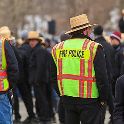 An Amish man is a fire police officer at a public auction in Lancaster County, Pennsylvania.