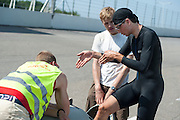 Sebastiaan Bowier stapt in de VeloX3. Op de Race Away baan bij Venray maakt de nieuwe fiets van het Human Powered Team Delft en Amsterdam, de VeloX3. Met de speciale ligfiets wil het team dat bestaat uit studenten van de TU Delft en de VU Amsterdam het wereldrecord fietsen verbreken. Dat staat nu op 133 km/h.<br /> <br /> At the Race Away track near Venray the new bike of the Human Powered Team Delft and Amsterdam, the VeloX3. With the special recumbent bike the team, consisting of students of the TU Delft and the VU Amsterdam, wants to set a new world record cycling. The current speed record is 133 km/h.
