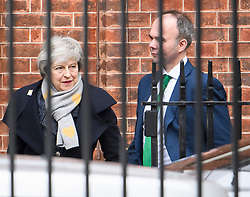 © Licensed to London News Pictures. 05/02/2019. London, UK. Prime Minister Theresa May leaves Downing Street with Number 10 Chief of Staff, Gavin Barwell. Mrs May is heading to Northern Ireland where she will meet with business leaders to re-assure them on Brexit issues and the EU withdrawal agreement. Photo credit: Ben Cawthra/LNP