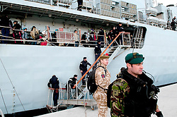 © under license to London News Pictures. 24/02/2011. Civilians board the Ship. The HMS Cumberland docks in the Port of Benghazi in Libya to evacuate 200 people from various nations. Photo credit should read Michael Graae/London News Pictures