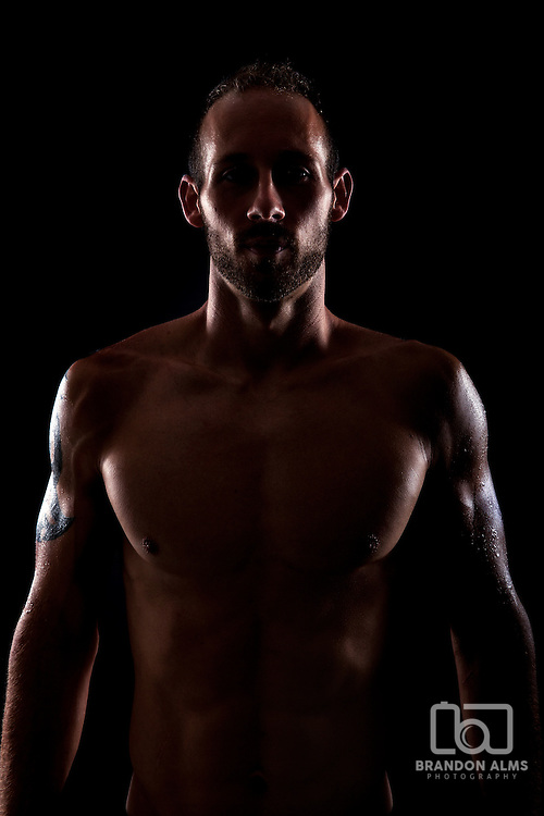 American Ninja Warrior contestant Adam Arnold posed in dramatic light