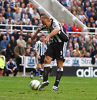 Photo: Back Page Images. 25/09/2004.<br /> Barclays Premiership. Newcastle United v W.B.A.<br /> Alan Shearer scores Newcastles 3rd goal of the afternoon