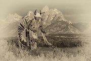 Shoshone Native American dancing in Traditional Regalia in front of the Grand Teton mountain range in NW Wyoming.