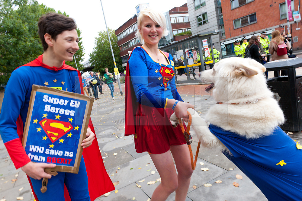 01/01/2017. Manchester, UK. Author & Illustrator Madeleina Kay 23 from Sheffield and activist Dominic Buxton 18 from London dress as Super EU Heroes to save UK from Brexit and play with Alba, a White Wolf dog at the rally. Anti-Brexit protesters gather in Manchester UK. to march on the 1st day of the Tory Party Conference. The Stop Brexit March is a national demonstration, supported by Prof AC Grayling & Alastair Campbell. It brings like-minded people together from across the country on Sunday 1 October 2017 to protest at the Conservative Party Conference: To demand one thing – #StopBrexit . Photo credit: Graham M. Lawrence/LNP