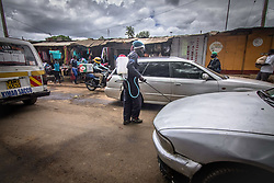 May 9, 2020, Nairobi, Kenya: Local health worker is seen along the streets spraying vehicles with Chemical disinfectant during the corona virus pandemic...Kenya has recorded 649 confirmed cases, 207 recovered and 30 deaths to the covid 19 disease. (Credit Image: © Donwilson Odhiambo/SOPA Images via ZUMA Wire)