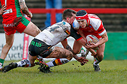 Bradford Bulls scrum half Brandon Pickersgill (24) tackles Keighley Cougars winger Harry Aaronson (28)  during the Betfred League 1 match between Keighley Cougars and Bradford Bulls at Cougar Park, Keighley, United Kingdom on 11 March 2018. Picture by Simon Davies.