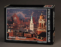 A very challening 672 piece Cincinnati puzzle featuring an Over the Rhine scene with Music Hall, Union Terminal, Old St. Mary's, and St. Pauls.  672 pieces, 18x24 size. $24.95