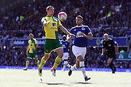 Graham Dorrans of Norwich City gets to the ball ahead of Kevin Mirallas of Everton. Barclays Premier League match, Everton v Norwich City at Goodison Park in Liverpool on Sunday 15th May 2016.<br /> pic by Chris Stading, Andrew Orchard sports photography.
