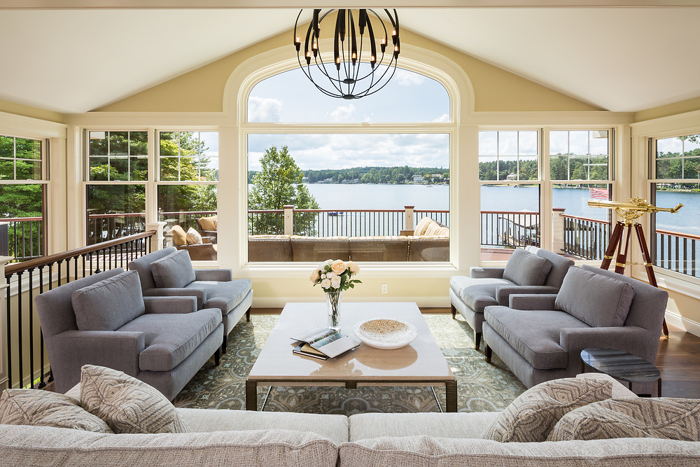 A living room interior of a home on Governor's Island in Gilford, NH, overlooking Lake Winnepesaukee. Client: Lauren Milligan Design, Lighthouse Contracting Group, & Daniels Electric Corporation.