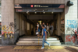 Hong Kong. 2 October 2019.  Many buildings and walls were vandalised and daubed with political slogans and anti-Chinese government and anti-police graffiti in Central and Wanchai districts by pro-democracy supporters on China's National Day on 1 October. Widespread clean-up operation is now underway. Vandalised entrance to Wanchai MTR station. Iain Masterton/Alamy Live News.