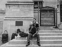 Resting on the steps of St. Thomas Church on Fifth Avenue and 53rd street in New York City.