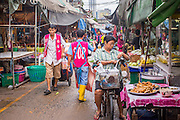 "03 OCTOBER 2012 - BANGKOK, THAILAND:    An aisle Khlong Toey (also called Khlong Toei) Market in Bangkok. It is one of the largest ""wet markets"" in Thailand. Thousands of people shop in the sprawling market for fresh fruits and vegetables as well meat, fish and poultry every day.       PHOTO BY JACK KURTZ"
