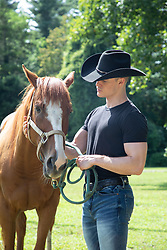 cowboy with his horse outdoors