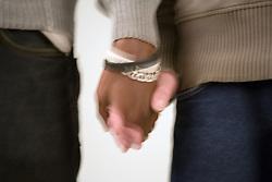 Portrait of a couple holding hands,