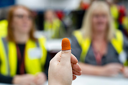 Edinburgh, Scotland, UK. 12th December 2019. Staff showing rubber thimble for counting ballot papers at Parliamentary General Election Count at the Royal Highland Centre in Edinburgh. Iain Masterton/Alamy Live News