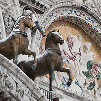 VENICE, ITALY - FEBRUARY 12: Two of the bronze horses of St Mark's Square are seen covered with snow flurry on February 12, 2012 in Venice, Italy. Italy, like most of Europe, is experiencing freezing temperatures, with the Venice Lagoon freeezing for the first time in over 20 years.