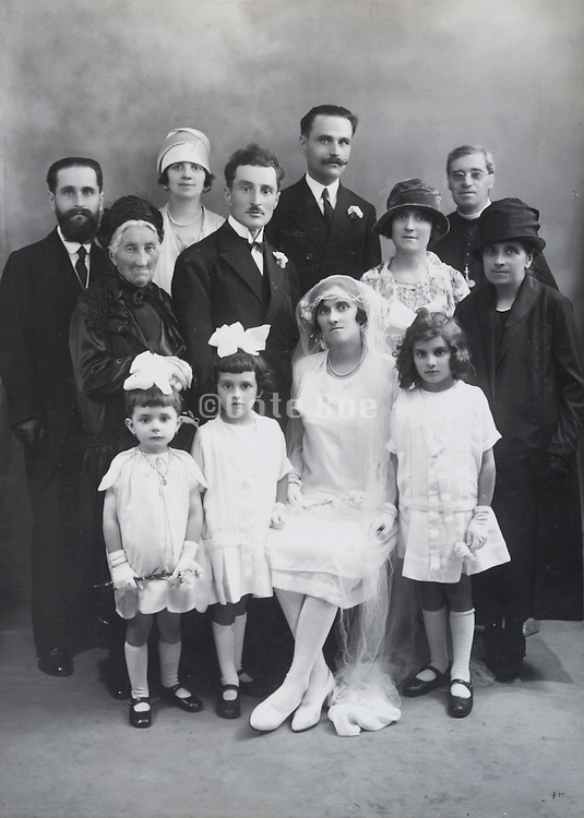 vintage group photo of groom and bride with family