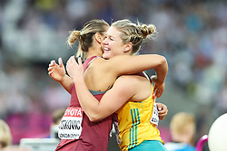 London, August 13 2017 . New world champion Sandra Perkovic  hugs silver medalist Dani Stevens of Australia after winning the women's discus on day ten of the IAAF London 2017 world Championships at the London Stadium. © Paul Davey.
