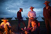 "Night fire. Cowboy life at and around the Spanish Ranch, near Elko in Nevada. These cowboys run a wagon every year for a couple of months: taking a motorized wagon several hours away from the ranch, to set up camp and watch over their cattle during summer...A 4-weeks road trip across the USA, from New York to San Francisco, on the steps of Jack Kerouac's famous book ""On the Road"".  Focusing on nomadic America: people that live on the move across the US, out of ideology or for work reasons."