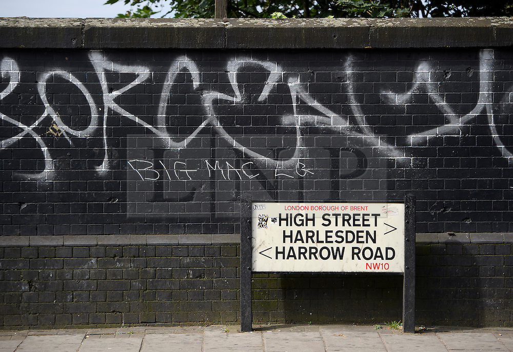 © Licensed to London News Pictures. 07/07/2016. London, UK. A street sign at the scene where a man was struck by a car following an assault on Harrow Road in Harlesden, north west London. Photo credit: Ben Cawthra/LNP